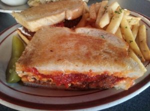 Chiggen Parm $9 chicken fried tofu, and cheese on buttery grilled cheese style bread.