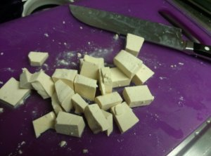 I had to chop my tofu to help the crumbling because it was the extra firm, sprouted kind.