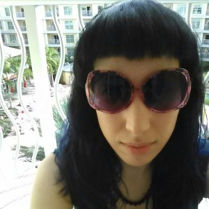 Here's me and my new bangs enjoying the balmy weather without enduring tanning, from the safety of our balcony.